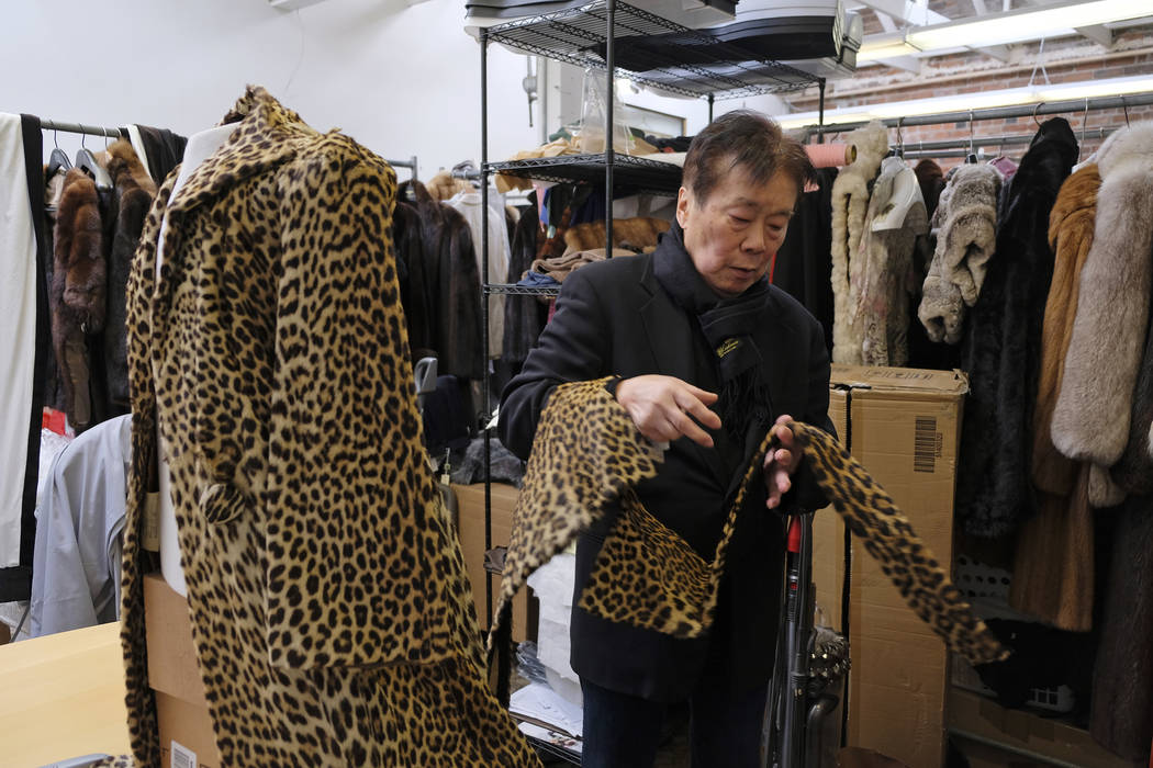 In this photo taken Friday, March 16, 2018, Benjamin Lin looks over a 60-year-old cheetah jacket he is restoring at the B.B. Hawk showroom in San Francisco. San Francisco could become the largest  ...