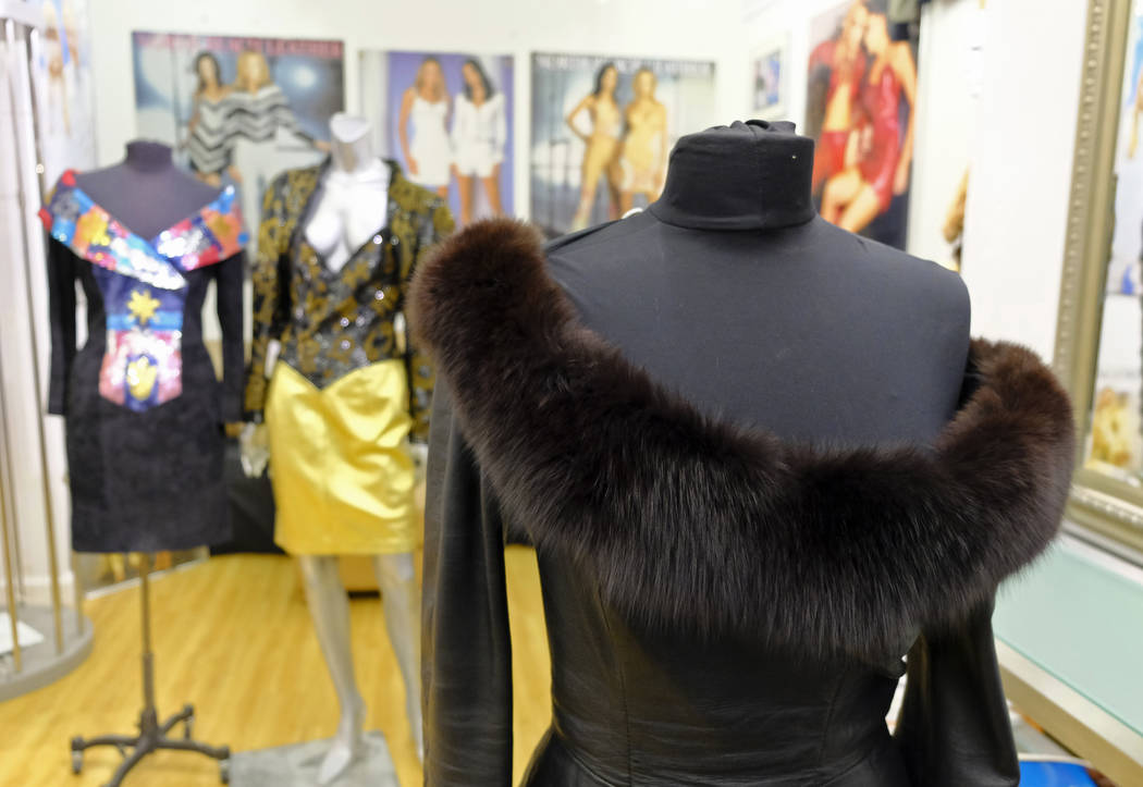 In this photo taken Thursday, March 15, 2018, a dress with a fox fur collar is displayed in the basement of West Coast Leathers in San Francisco. San Francisco could become the largest U.S. city t ...