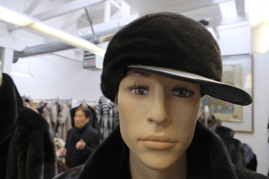In this photo taken Friday, March 16, 2018, a hat sits on a mannequin as Benjamin Lin talks about the possible closure of the B.B. Hawk showroom in San Francisco because of a possible ban on the s ...
