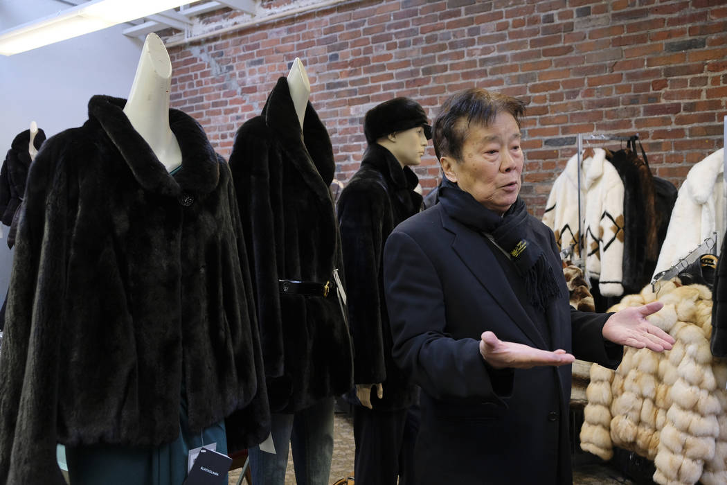 In this photo taken Friday, March 16, 2018, Benjamin Lin gestures while talking about the possible closure of the B.B. Hawk showroom because of a ban on the sales of fur in San Francisco. San Fran ...