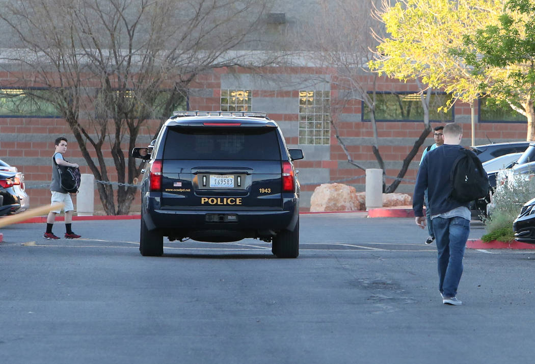A police vehicle is seen as students arrive at Foothill High School on Wednesday, March 21, 2018, in Henderson. The school will have an increased police presence today after someone made an unspec ...