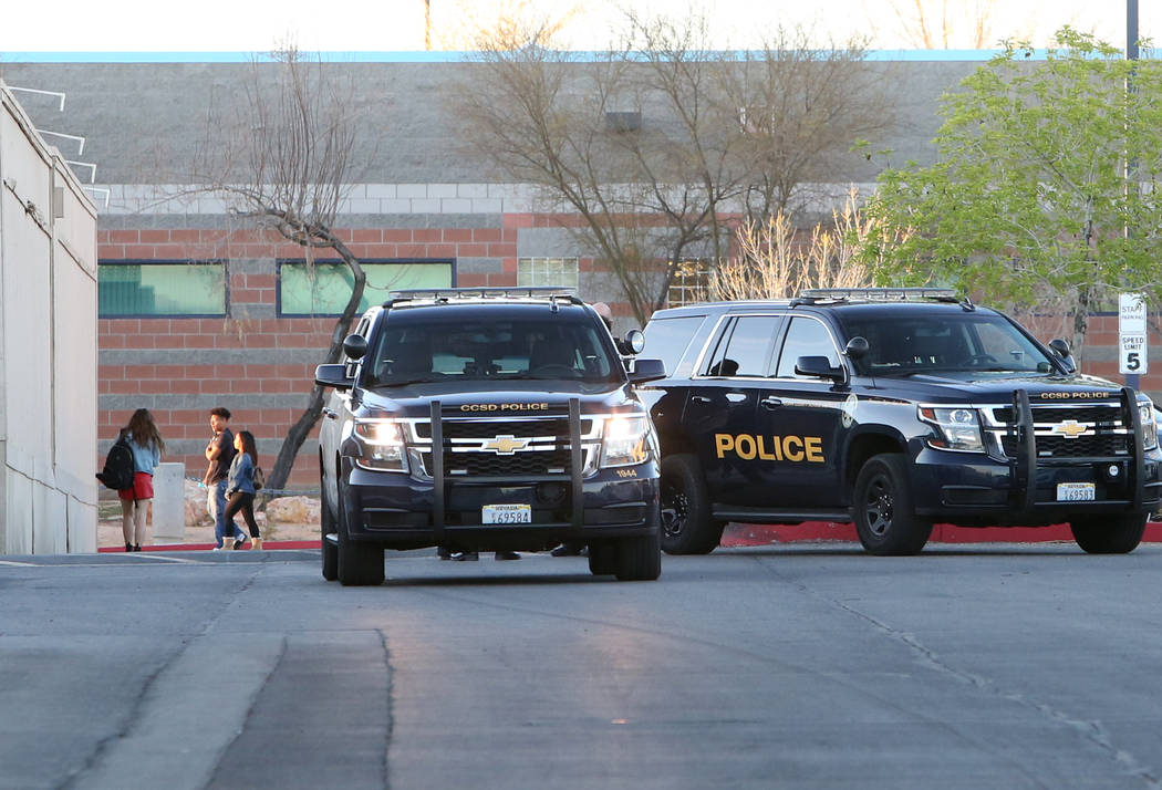 Police vehicles are seen as students arrive at Foothill High School on Wednesday, March 21, 2018, in Henderson. The school will have an increased police presence today after someone made an unspec ...