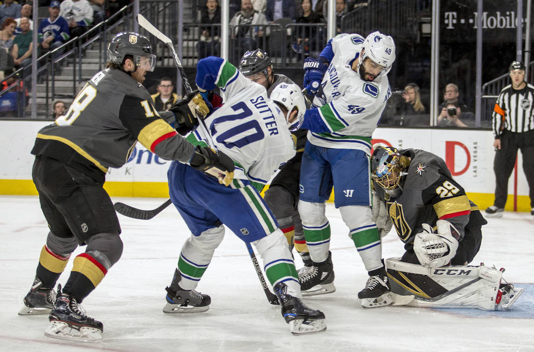 Vegas Golden Knights goaltender Marc-Andre Fleury (29) stops a shot by Vancouver Canucks center Brandon Sutter (20) during the first period of an NHL hockey game Tuesday, March 20, 2018, in Las Ve ...