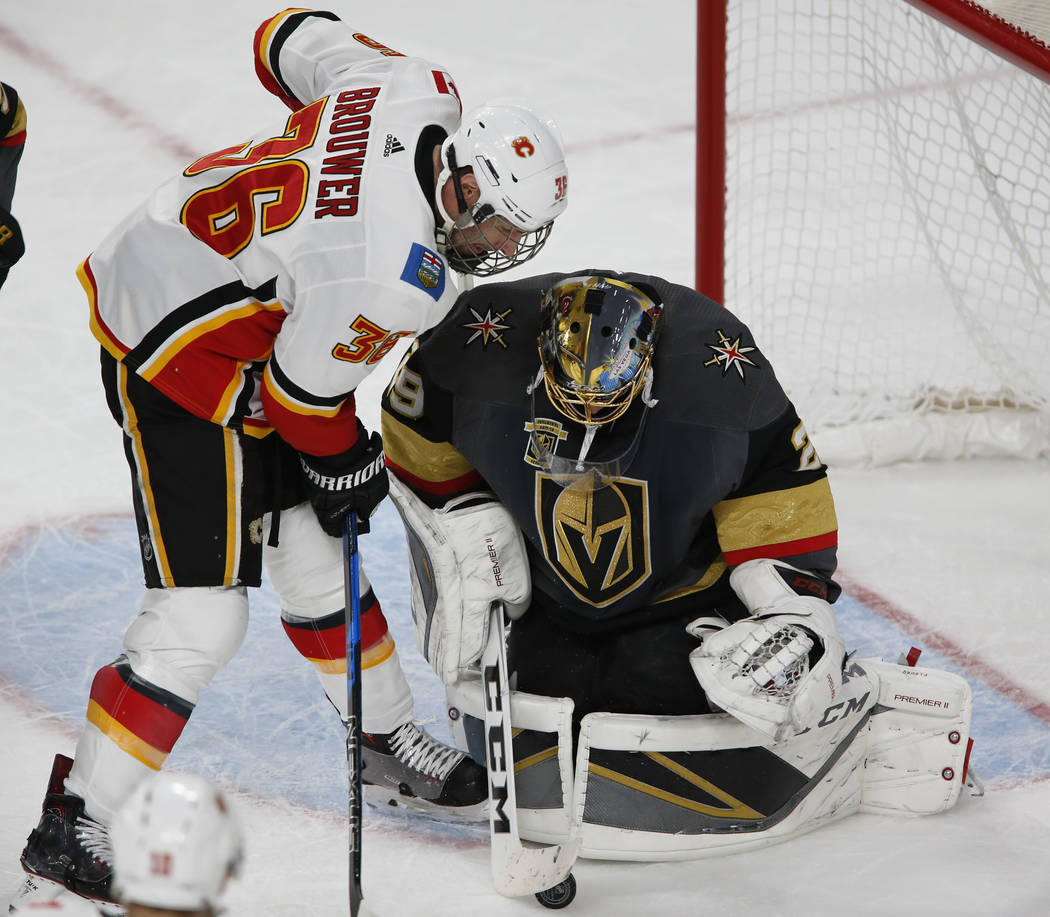 Calgary Flames right wing Troy Brouwer (36) loses the puck to Vegas Golden Knights goaltender Marc-Andre Fleury (29) during the first period of an NHL hockey game between the Vegas Golden Knights  ...