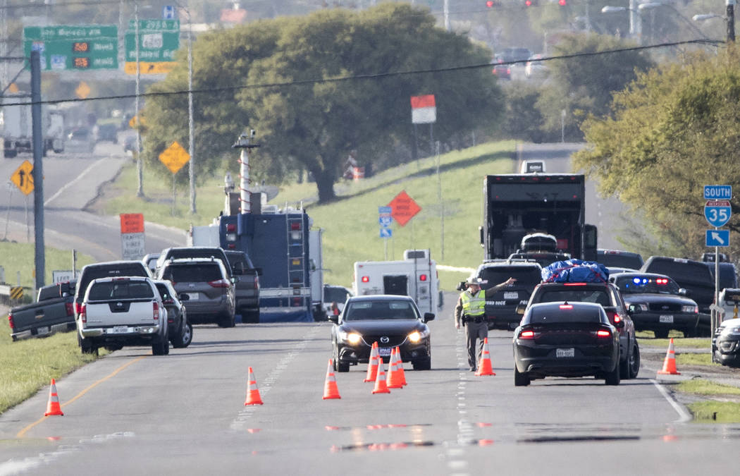 Officials work at a blocked off area near where a suspect in a series of bombing attacks in Austin blew himself up as authorities closed in, Wednesday, March 21, 2018, in Round Rock, Texas. (Ricar ...