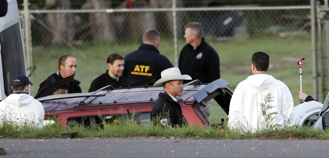 Officials investigate the scene where a suspect in a series of bombing attacks in Austin blew himself up as authorities closed in, Wednesday, March 21, 2018, in Round Rock, Texas. (Eric Gay/AP)