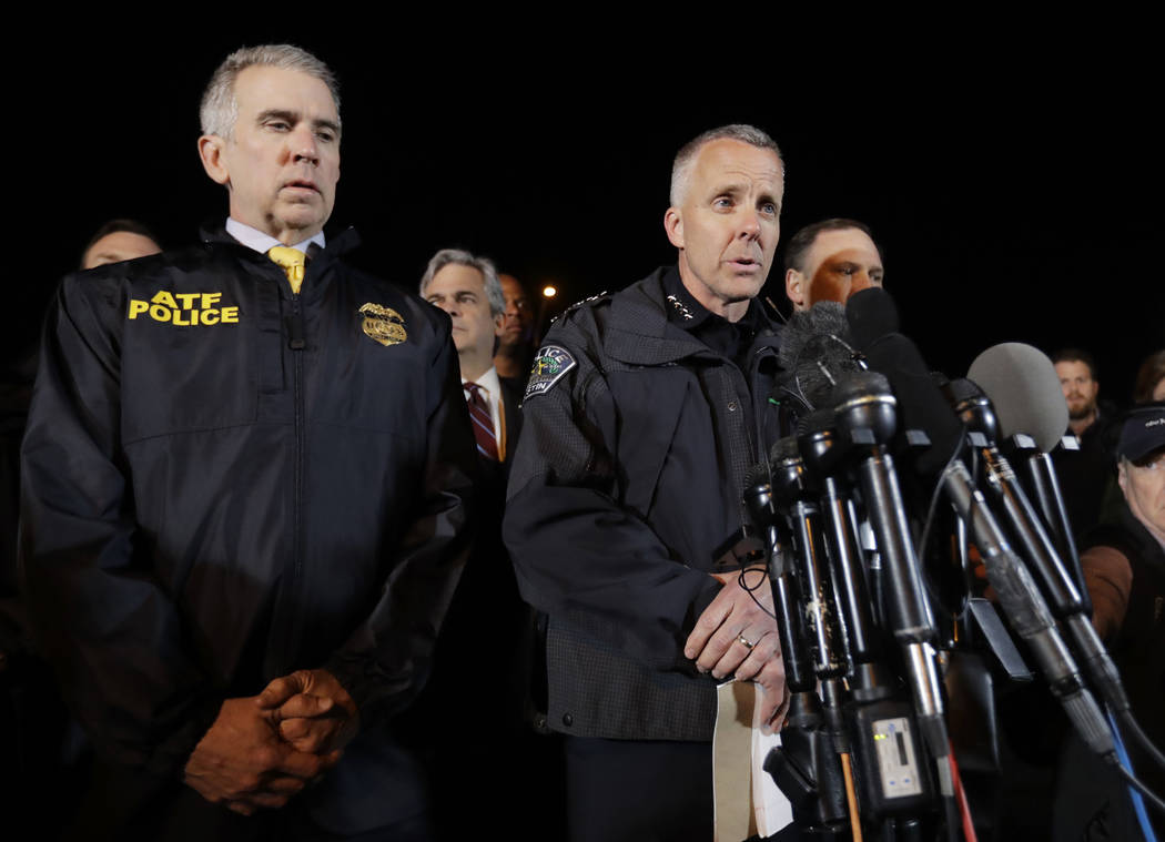 Interim Austin Police Chief Brian Manley, right, stands with other members of law enforcement as he briefs the media, Wednesday, March 21, 2018, in the Austin suburb of Round Rock, Texas. The susp ...