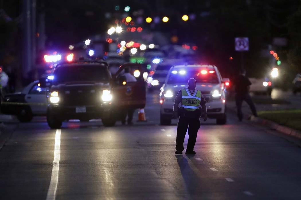 Emergency vehicles stage near the site of another explosion, Tuesday, March 20, 2018, in Austin, Texas. Early Wednesday morning, police were in a gunfight with a suspect in the bombings. (AP Photo ...