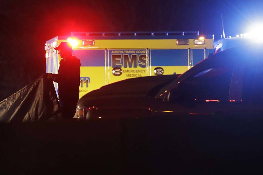 Officials work at the scene where the suspect in a spate of bombing attacks that have terrorized Austin over the past month blew himself up with an explosive device as authorities closed in, the p ...