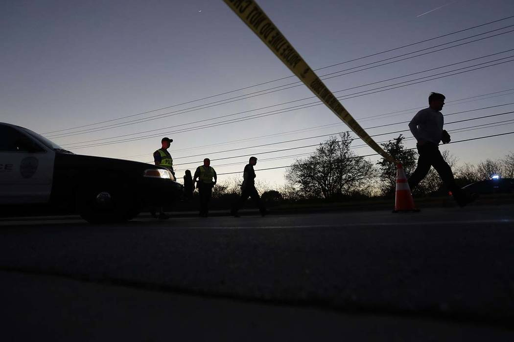 A man runs from an area near the site of an explosion, Tuesday, March 20, 2018, in Austin, Texas. Emergency teams were responding Tuesday night to another reported explosion in Texas' capital, thi ...