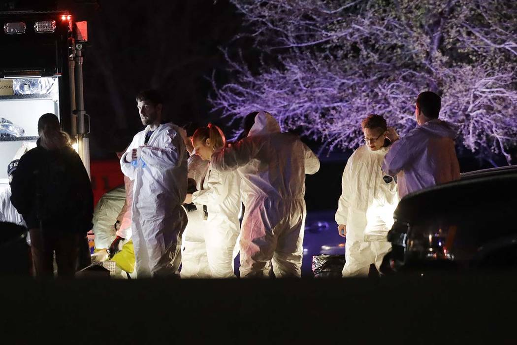 Members of law enforcement stage near the area where a suspect in a series of bombing attacks in Austin blew himself up as authorities closed in, Wednesday, March 21, 2018, in Round Rock, Texas. ( ...