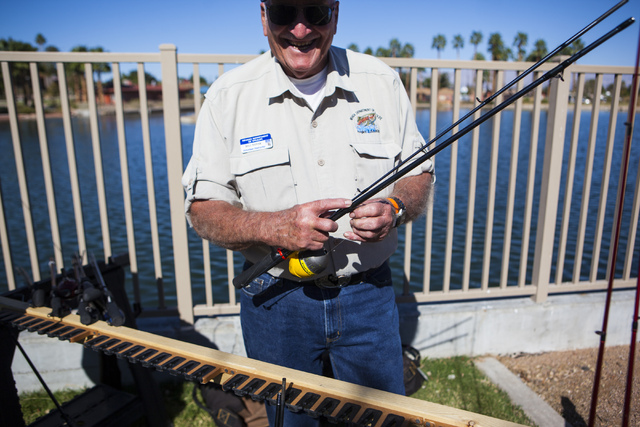 Bill Novak, a volunteer fishing instructor with the Nevada Department of Wildlife, packs up fishing rods during a senior fishing derby held by Las Vegas City Councilman Ricki Barlow at Lorenzi Par ...