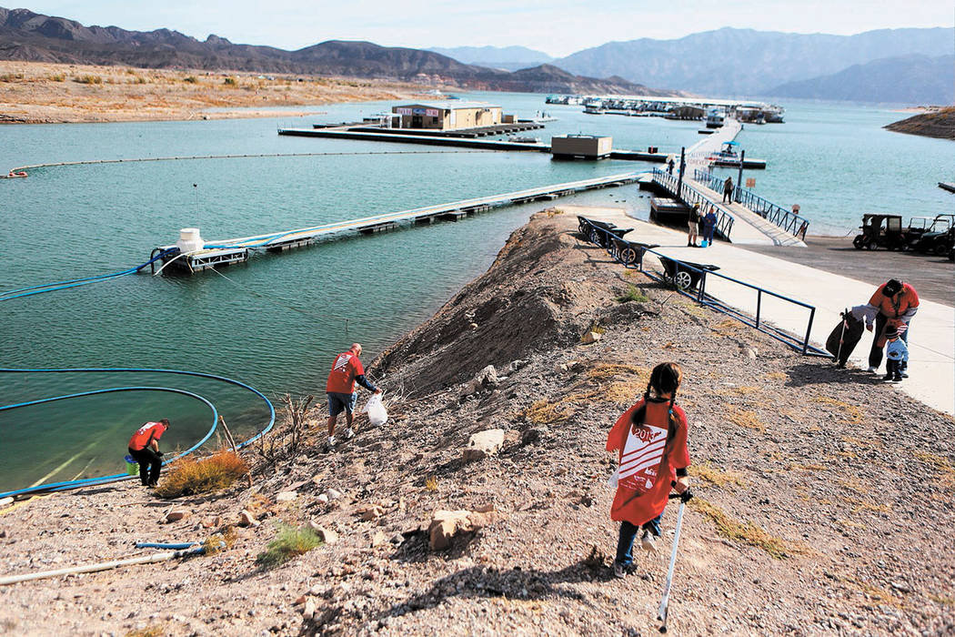 Volunteers pick up trash at Callville Bay Resort and Marina in Lake Mead National Recreation Area Saturday, Nov. 16, 2013. (Las Vegas Review-Journal)