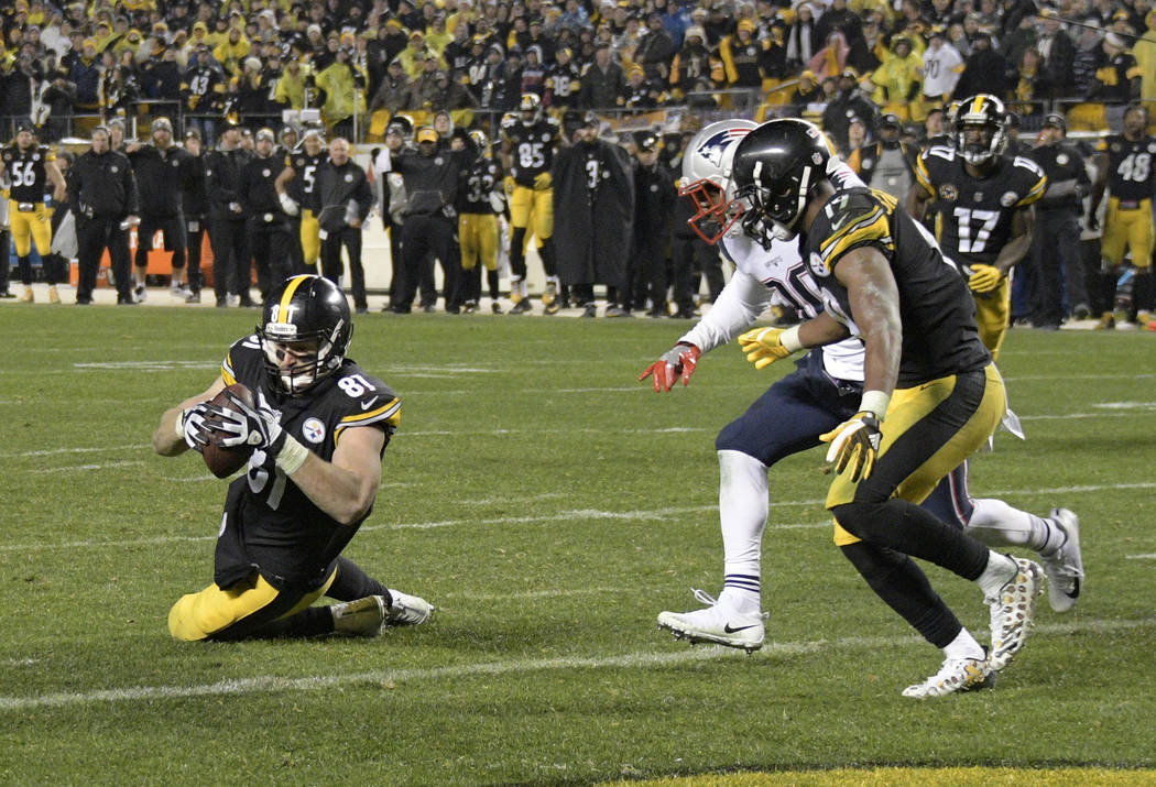 Pittsburgh Steelers tight end Jesse James (81) has a knee down before crossing the goal line with a pass from quarterback Ben Roethlisberger during the second half of an NFL football game against  ...