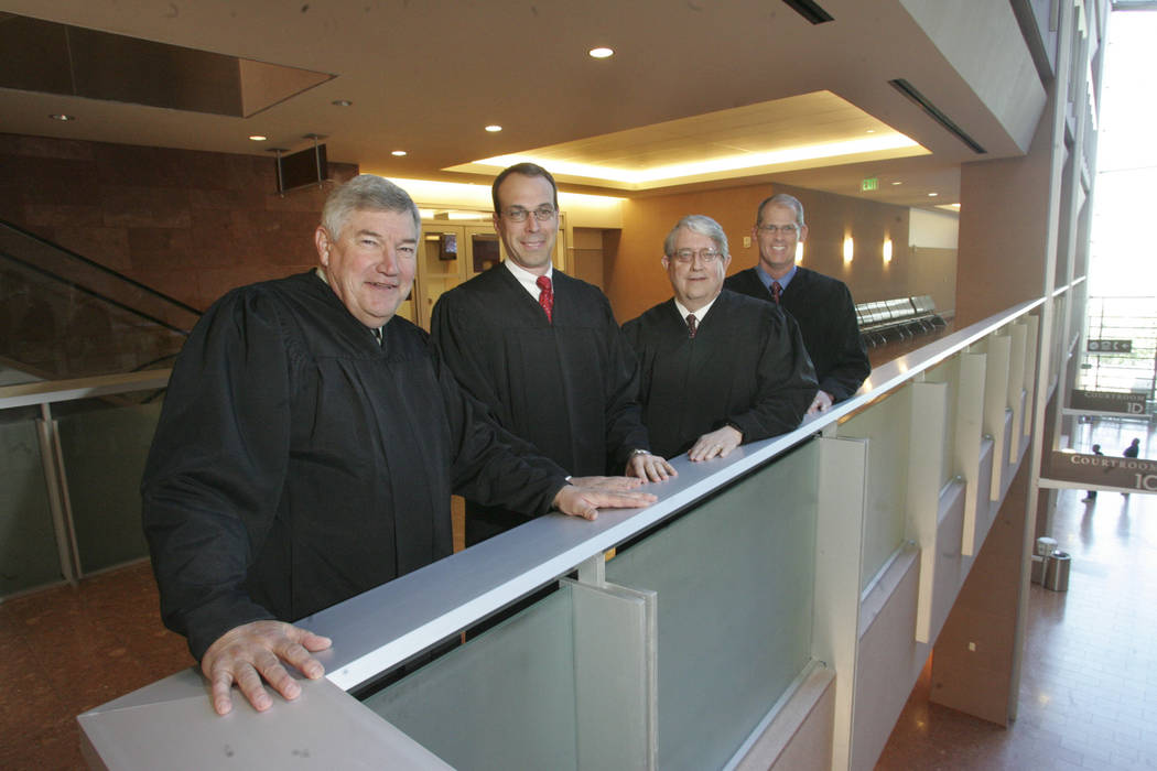 Overlooking the foyer of the new Regional Justice Center are, from left, District Judge Stewart Bell, District Judge David Wall, District Judge Allan Earl, and District Judge Douglas Herndon, on A ...