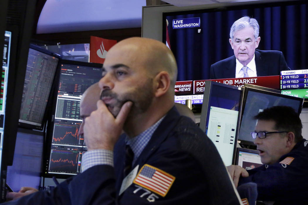 The Washington news conference of Federal Reserve Chairman Jerome Powell appears on a television on the floor of the New York Stock Exchange, Wednesday, March 21, 2018. The Federal Reserve is rais ...