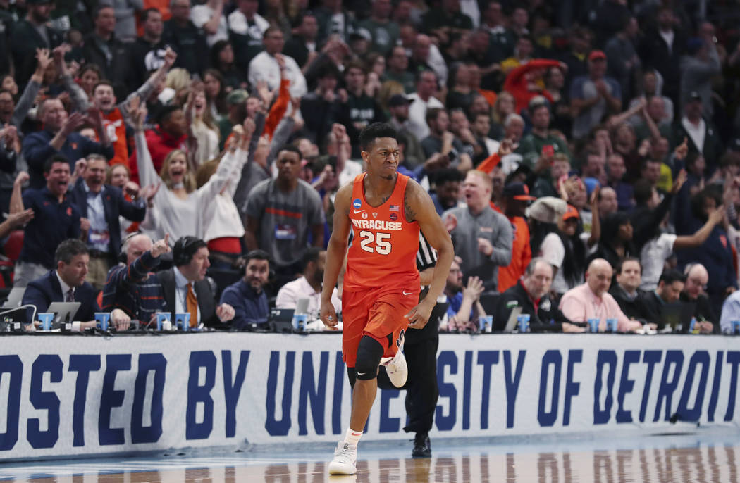 Syracuse guard Tyus Battle (25) heads to the other end after a 3-point basket during the closing minutes of a second-round game against Michigan State in the NCAA men's college basketball tourname ...