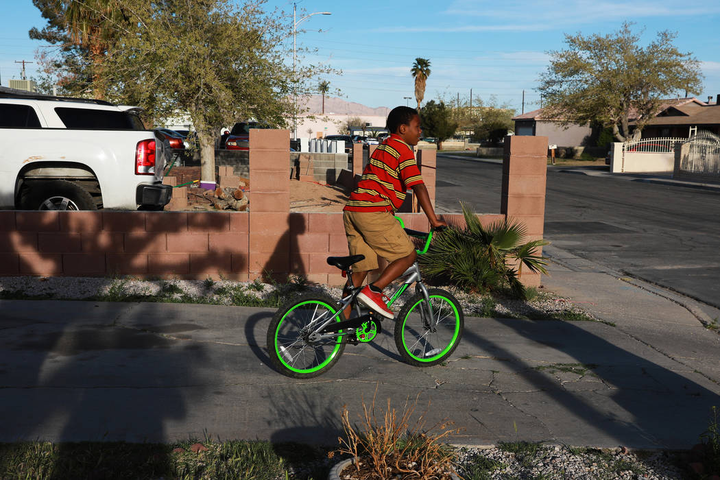 Jamarie Williams, 10, rides his bike at his uncle Howard Williams' house in Las Vegas on Thursday, March 29, 2018. Andrea Cornejo Las Vegas Review-Journal @dreacornejo