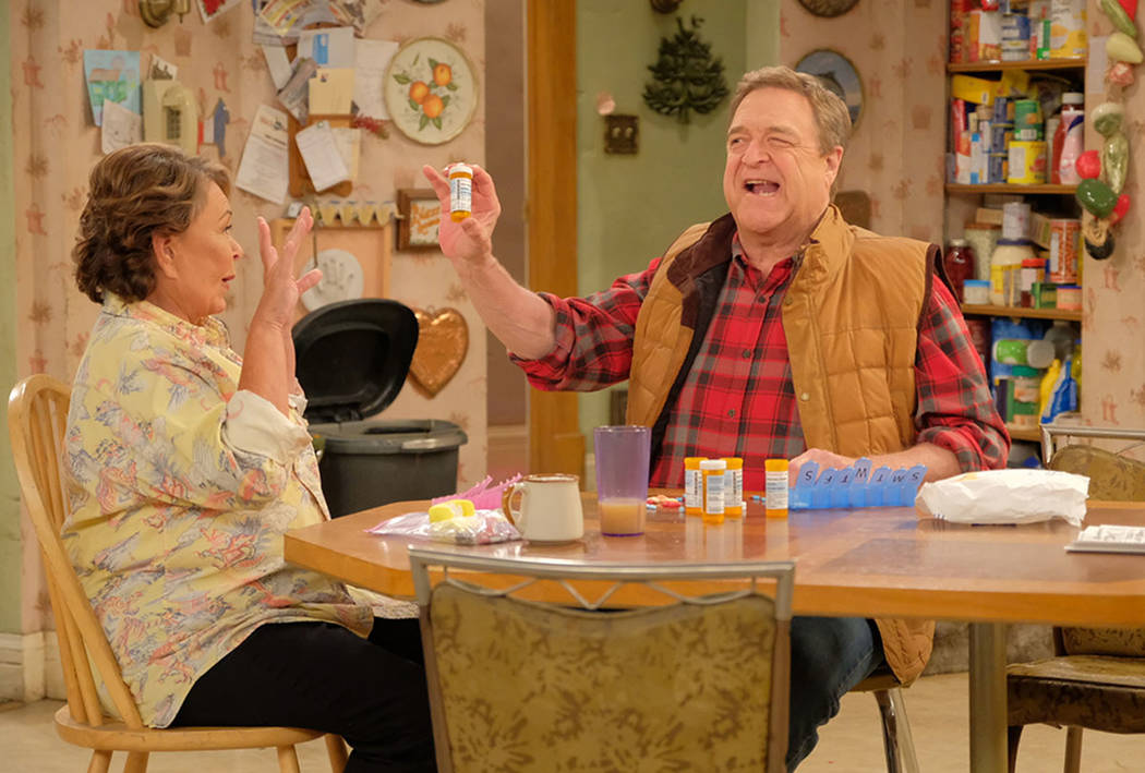 """Roseanne and Dan talk during the first episode of the revival of """"Roseanne"""" (ABC/Adam Rose)"""