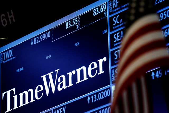 Ticker and trading information for media conglomerate Time Warner Inc. is displayed at the post where it is traded on the floor of the New York Stock Exchange in New York. (Brendan McDermid/Reuters)
