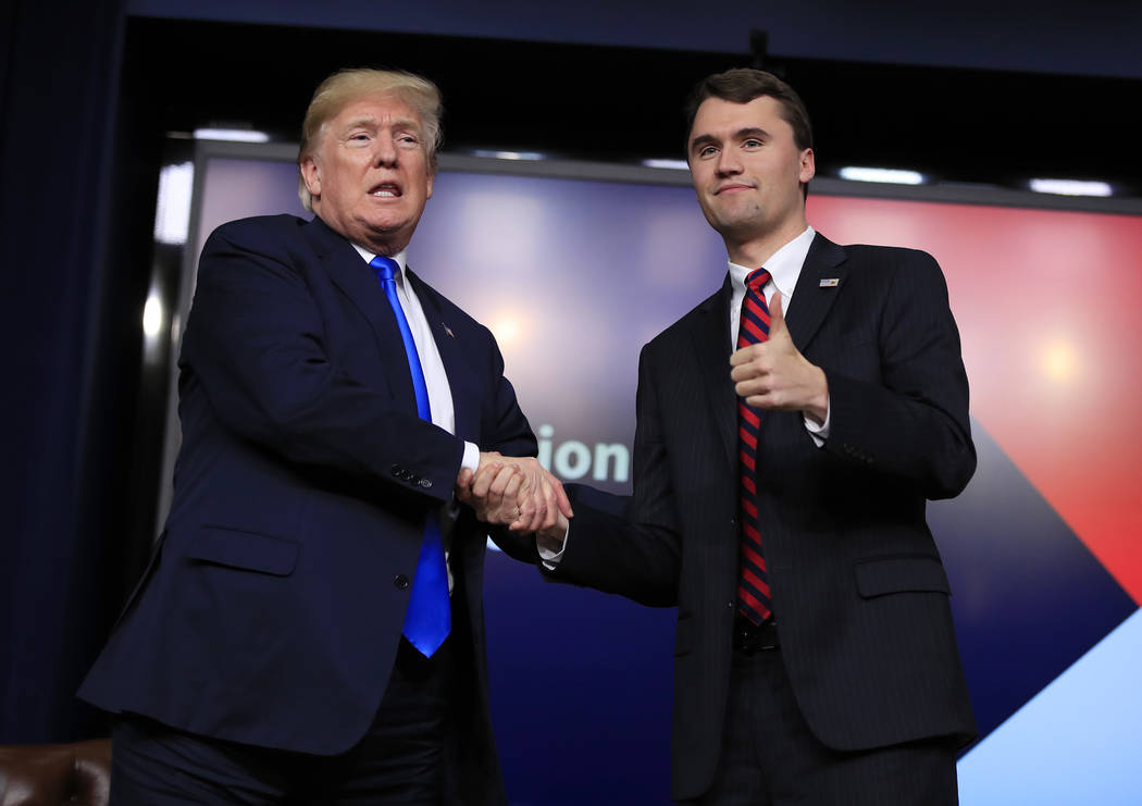 President Donald Trump shakes hands with moderator Charlie Kirk, during a Generation Next White House forum at the Eisenhower Executive Office Building on the White House complex in Washington, Th ...