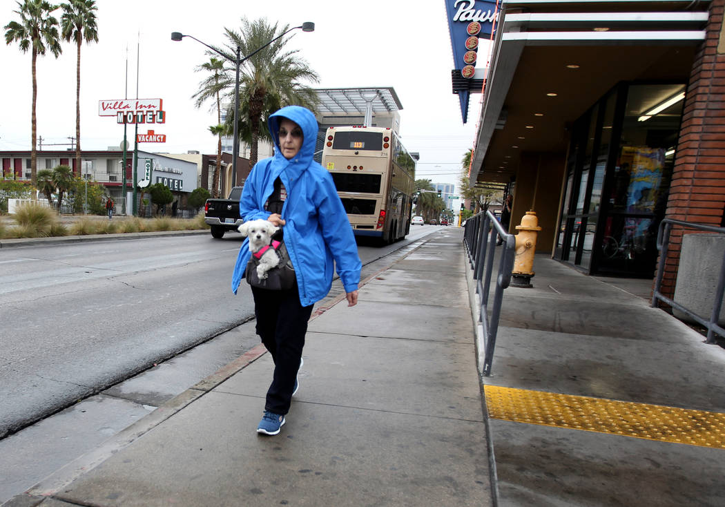 A woman who declined to give her name walks up Las Vegas Boulevard North in downtown Las Vegas in a light rain, Thursday, March 22, 2018. K.M. Cannon Las Vegas Review-Journal @KMCannonPhoto