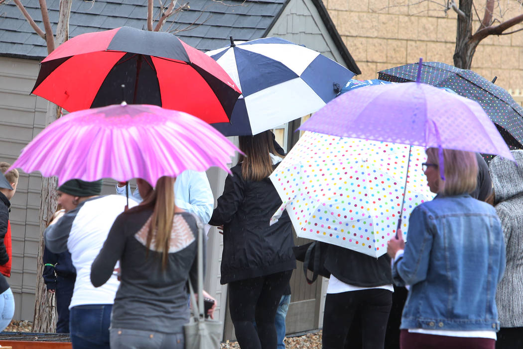Parents arrive holding umbrellas in the rain at Somerset Academy to attend a planting ceremony for their brand new garden on Thursday, March 22, 2018, in Las Vegas. Bizuayehu Tesfaye/Las Vegas Rev ...