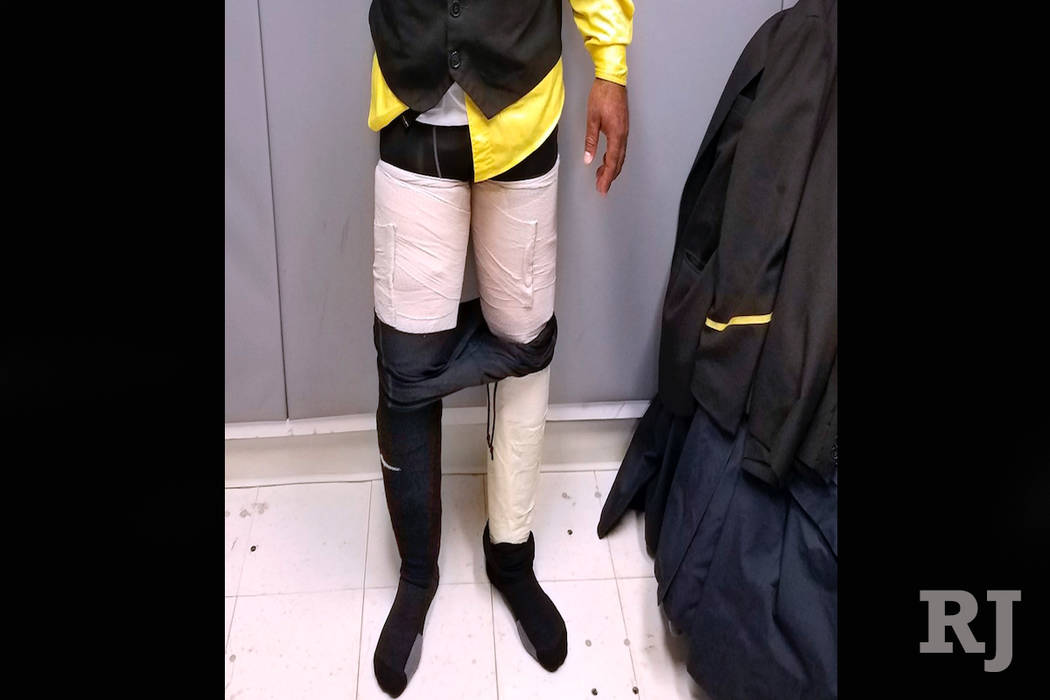 This photo provided by the U.S. Customs and Border Protection on Thursday, March 22, 2018, shows Fly Jamaica Airways crew member Hugh Hall as he was searched and arrested at New York's Kennedy Air ...