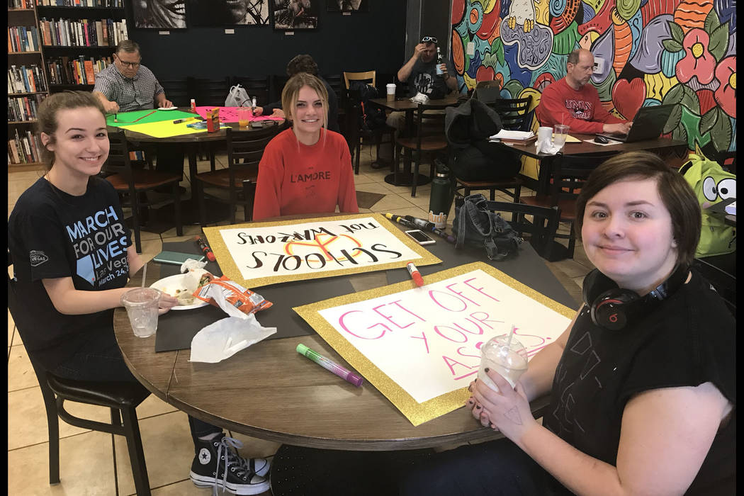 Students Sierra McAfee-Darrough, from left, Taylor Lane and Sadie Little make signs at a coffee shop in Las Vegas on Thursday, March 22, 2018, in preparation for the nationwide March For Our Lives ...