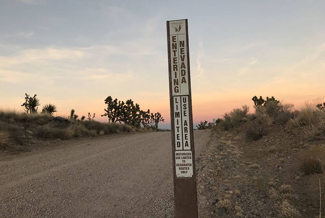 A sign marks the state line on a dirt road west of Searchlight on Nov. 25, 2017. A wind farm with as many as 220 40-story turbines has been proposed on the Nevada side of the line. Henry Brean Las ...