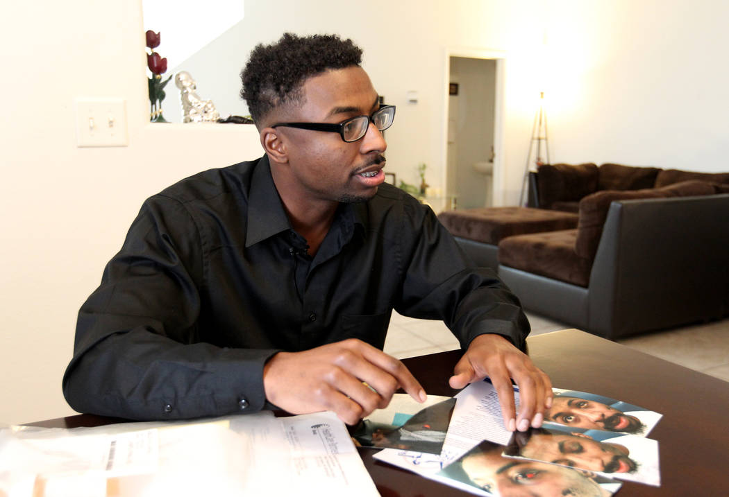 David McCovy, 23, shows photos of his injuries to a reporter during an interview at his mother's Las Vegas home Wednesday, March 14, 2018. McCovy claims he was physically assaulted and punched by  ...
