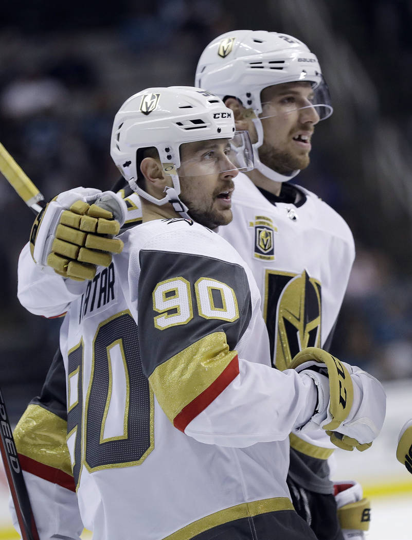 Vegas Golden Knights' Tomas Tatar, left, celebrates his goal with teammate Shea Theodore during the first period of an NHL hockey game against the San Jose Sharks on Thursday, March 22, 2018, in S ...