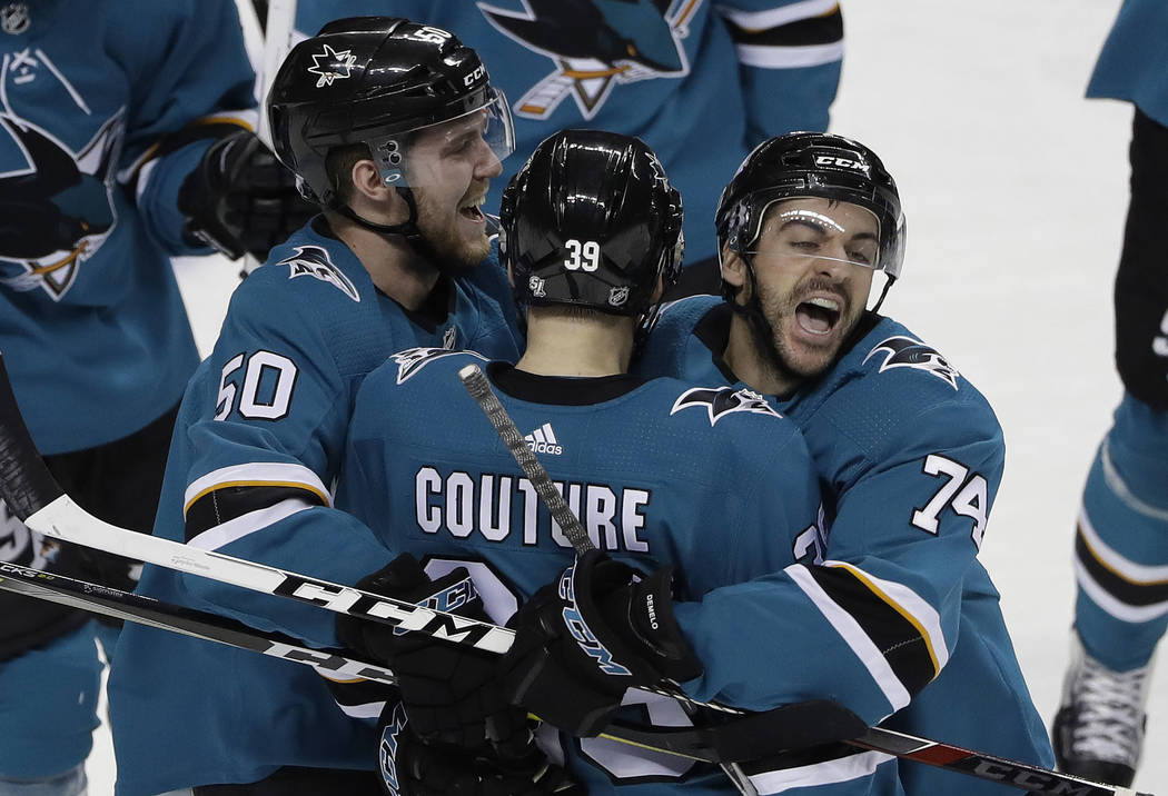 San Jose Sharks' Logan Couture, center, celebrates his game-winning goal with teammates Dylan DeMelo (74) and Chris Tierney (50) in overtime of an NHL hockey game against the Vegas Golden Knights  ...