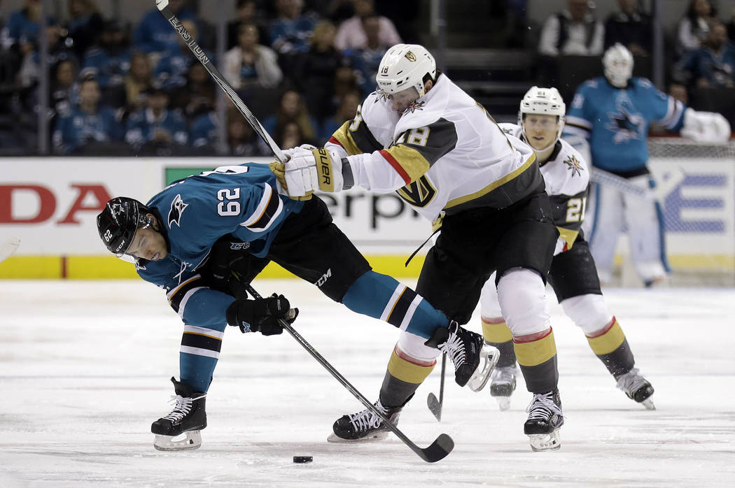 San Jose Sharks' Kevin Labanc (62) vies for the puck against Vegas Golden Knights' James Neal during the second period of an NHL hockey game Thursday, March 22, 2018, in San Jose, Calif. (AP Photo ...