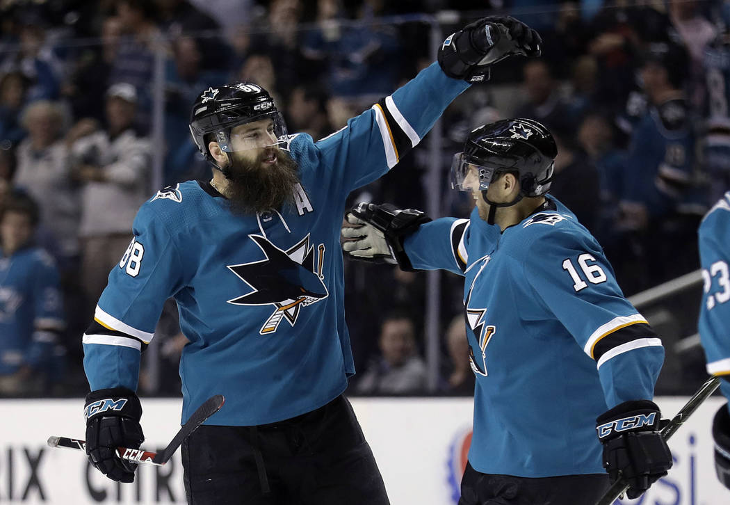 San Jose Sharks' Brent Burns, left, celebrates with teammate Eric Fehr after Burns scored against the Vegas Golden Knights during the second period of an NHL hockey game Thursday, March 22, 2018,  ...