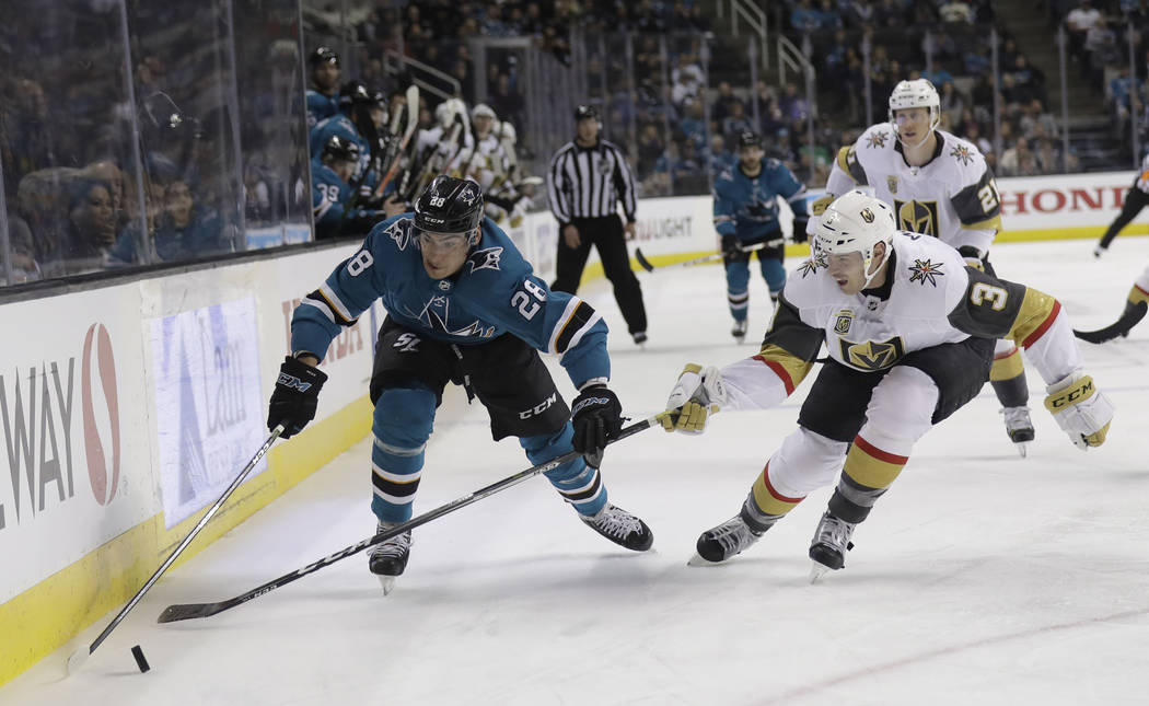 San Jose Sharks' Timo Meier, left, is defended by Vegas Golden Knights' Brayden McNabb during the second period of an NHL hockey game Thursday, March 22, 2018, in San Jose, Calif. (AP Photo/Marcio ...