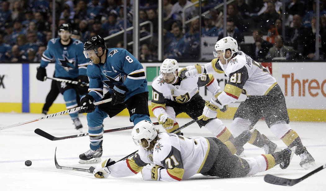 San Jose Sharks' Joe Pavelski, left, works around Vegas Golden Knights' William Karlsson, bottom, Tomas Tatar, center, and Jonathan Marchessault, top right, during the second period of an NHL hock ...