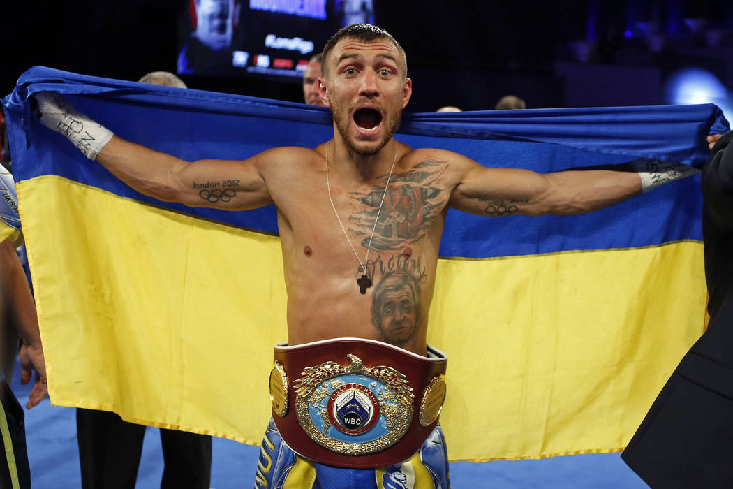 Vasyl Lomachenko, of Ukraine, celebrates after defeating Guillermo Rigondeaux during a WBO junior lightweight title boxing match Saturday, Dec. 9, 2017, in New York. (AP Photo/Adam Hunger)