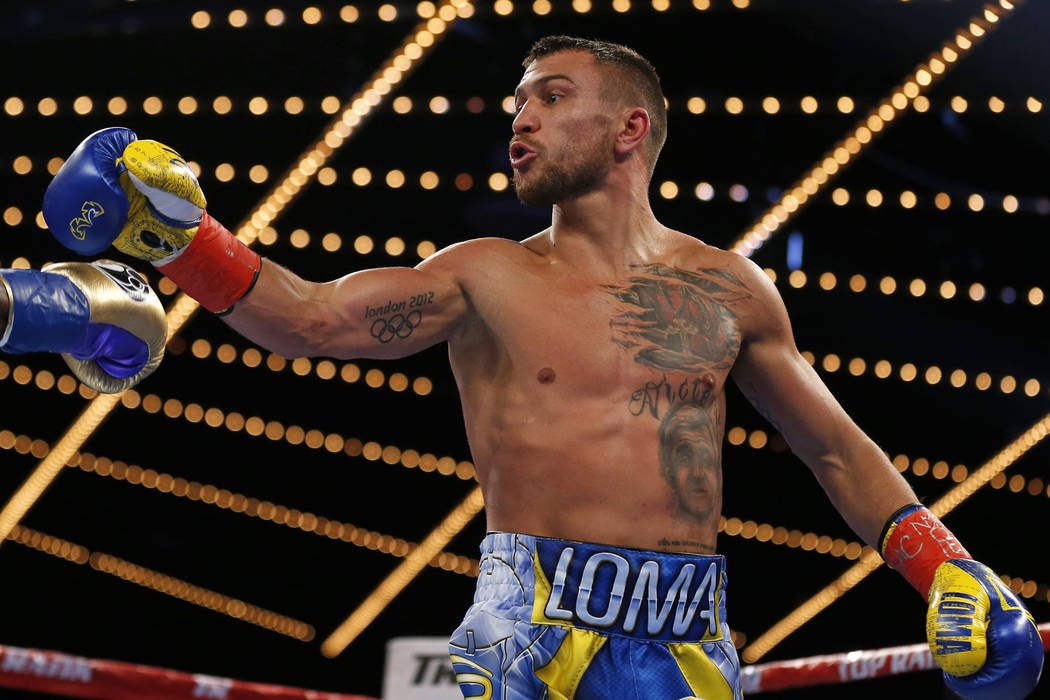 Vasyl Lomachenko, of Ukraine, reacts toward Guillermo Rigondeaux at the end of the second round of a WBO junior lightweight title boxing match Saturday, Dec. 9, 2017, in New York. Lomachenko won t ...