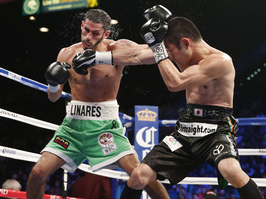 Jorge Linares of Barinas Venezuela, left, trades punches with Nihito Arakawa of Musashino Japan during their lightweight boxing match, Saturday, March 8, 2014, at The MGM Grand Garden Arena in Las ...