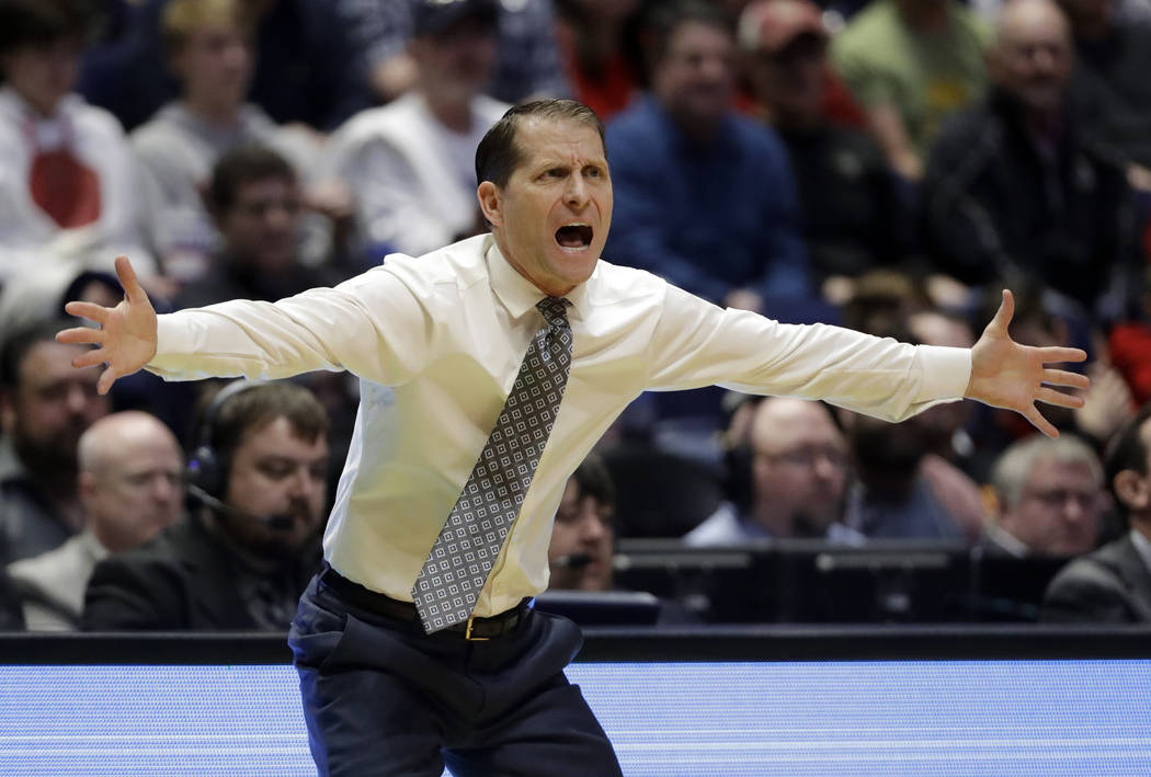 Nevada head coach Eric Musselman reacts to a play, during the first half of a second-round game against Cincinnati in the NCAA college basketball tournament in Nashville, Tenn., Sunday, March 18,  ...
