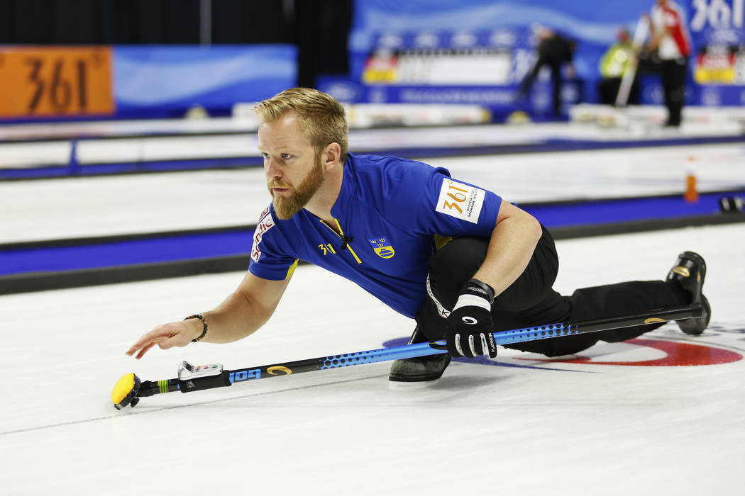 Team Sweden's Niklas Edin delivers the rock to sweepers during the round-robin games for the World Men's Curling Championship 2018 at the Orleans Arena in Las Vegas on Saturday, March 31, 201 ...