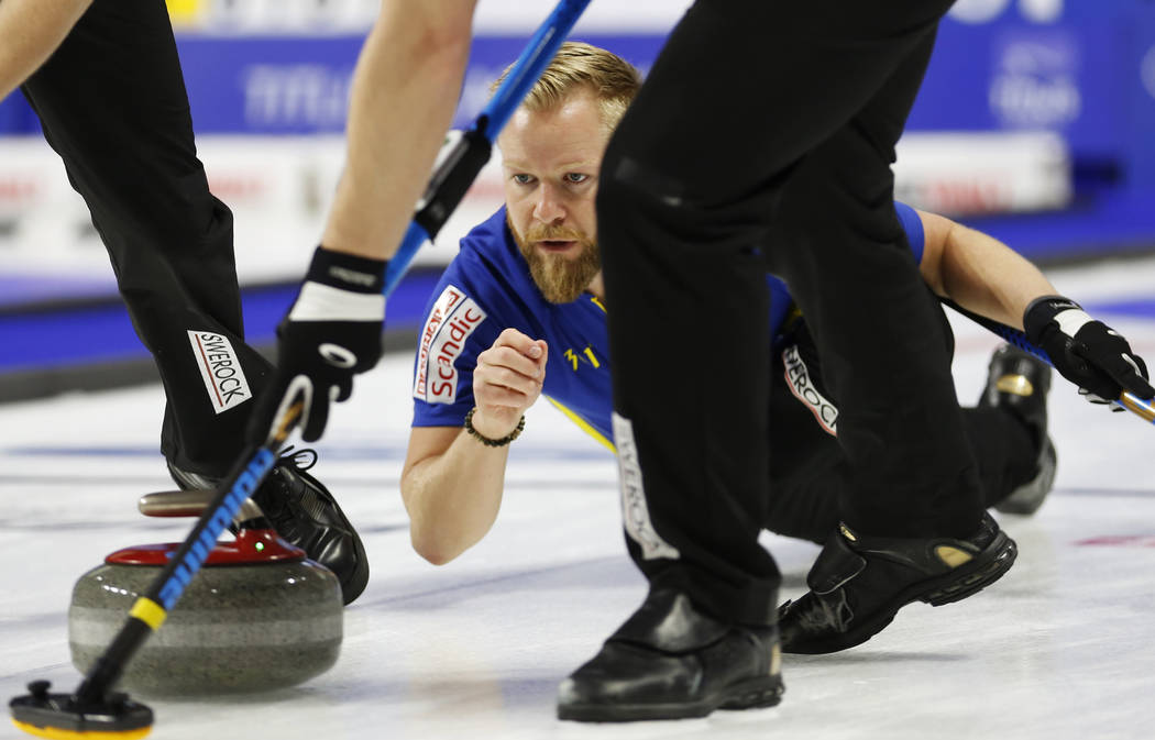 Team Sweden's Niklas Edin delivers the rock to sweepers during the round-robin games for the World Men's Curling Championship 2018 at the Orleans Arena in Las Vegas on Saturday, March 31, 2018. An ...