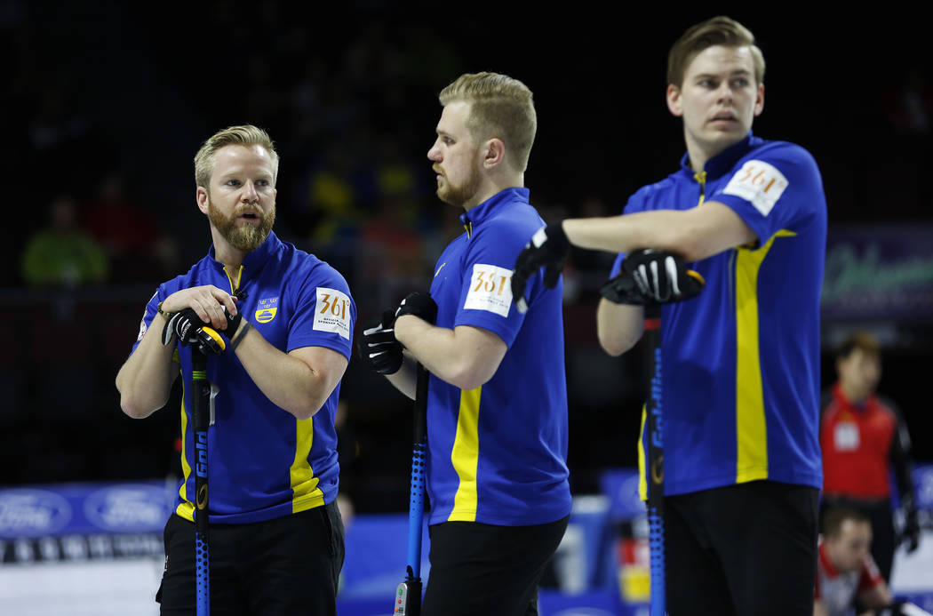 Team Sweden's Niklas Edin talks to teammates Rasmus Wranaa, center, and Oskar Eriksson during the round-robin games for the World Men's Curling Championship 2018 at the Orleans Arena in Las V ...