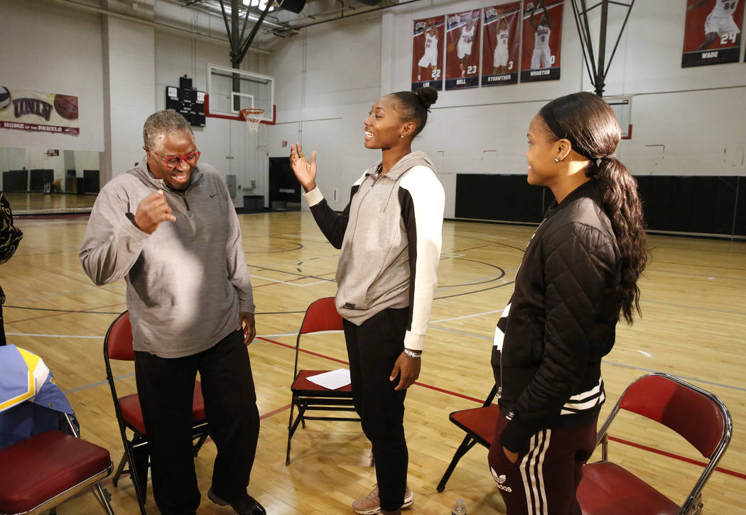 Women's basketball pioneer Cardte Hicks, left, chats with the Las Vegas Aces players Sequoia Holmes, center, and Moriah Jefferson, at UNLV's basketball practice court on Monday, March 26, 2018, in ...