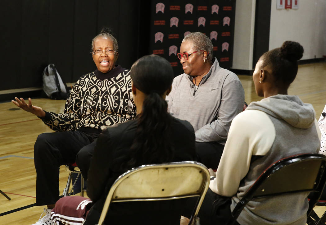 Women's basketball pioneers Musiette McKinney, left, and Cardte Hicks, chat with the Las Vegas Aces players Moriah Jefferson, second left, and Sequoia Holmes at UNLV's basketball practice court on ...