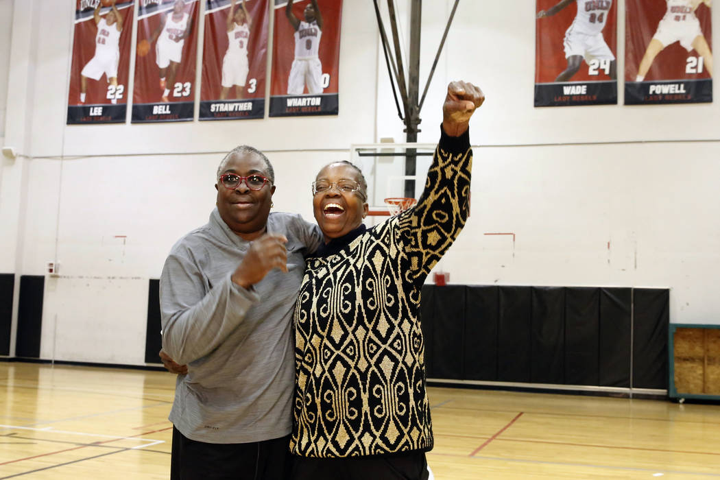 Women's basketball pioneers Cardte Hicks, left, and Musiette McKinney react as they reunited after 30 years at UNLV's basketball practice court on Monday, March 26, 2018, in Las Vegas. Hicks and M ...