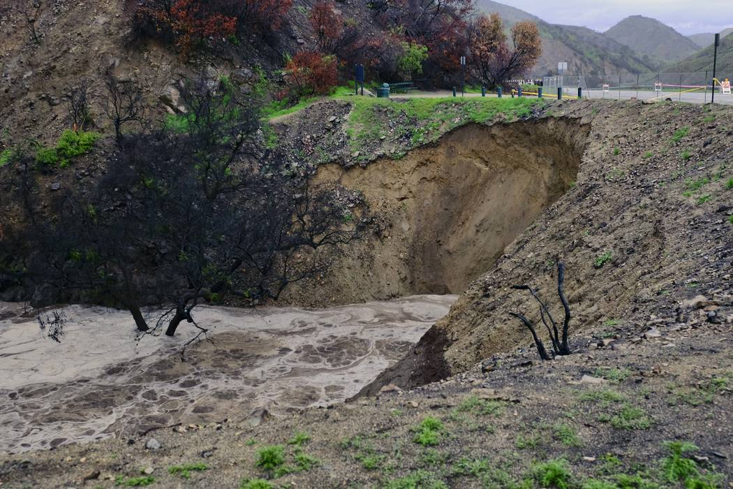 Rain causes a hillside to collapse along La Tuna Canyon Road in Los Angeles on Thursday, March 22, 2018, where mandatory evacuation orders had already been in place amid moderate to heavy rain in  ...