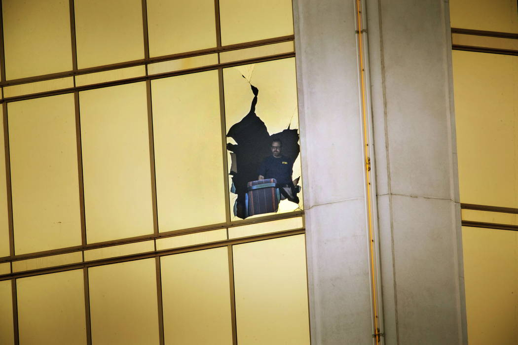 The FBI investigates the scene on the 32nd-floor of the Mandalay Bay on Wednesday, Oct. 4, 2017, in Las Vegas. (Richard Brian Las Vegas Review-Journal)