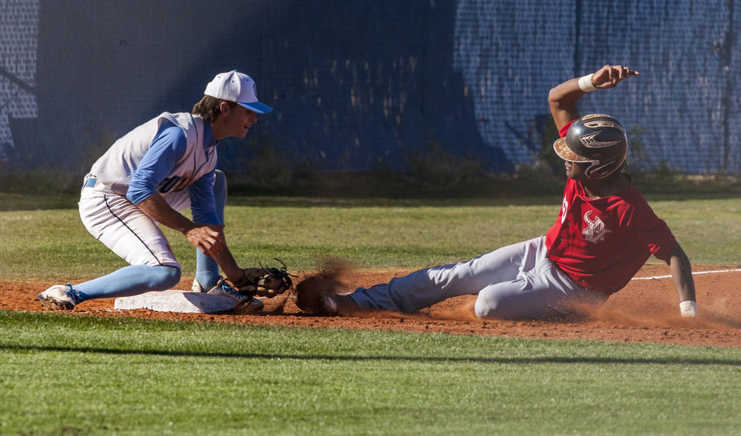 Centennial third baseman Zachary Hare tags Arbor View outfielder Niles Scarfati out at third during the third inning at Centennial Hills High School in Las Vegas on Friday, March 23, 2018. Centenn ...